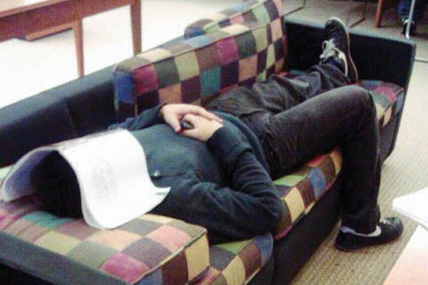 NJCU student asleep in the Frank J. Guarini Library, a common site around finals week. Photo by Samantha Colon