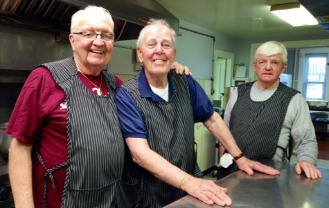 From left to right: St. John's Parish Manager Vincent Smith, Tuesday Crew volunteer Buddy McNulty, and John McGlinchy