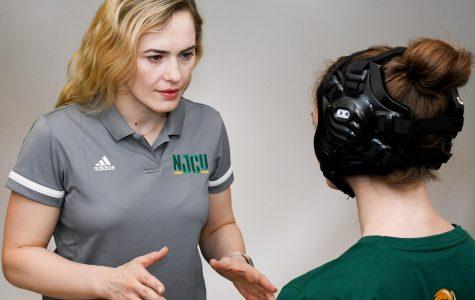 U.S. Olympian is women's wrestling coach