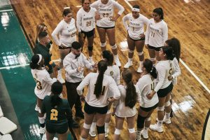 Coach Justin Beaumont and the Women's  Volleyball Team last season.